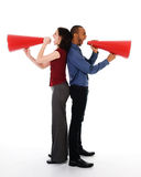 Megaphone Team. Two business people on isolated white with red megaphones Stock Photo