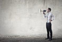 Megaphone user. Business man is using megaphone Stock Photo