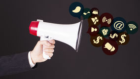 Megaphone With web icons Social media. Shopping Concept Stock Photos