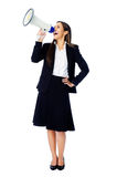 Megaphone woman. Business woman with megaphone yelling and screaming isolated on white background with suit and high heels royalty free stock image