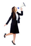 Megaphone woman. Business woman with megaphone yelling and screaming isolated on white background with suit and high heels stock photography