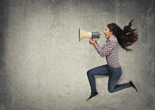 Megaphone. Woman is speaking to a megaphone Royalty Free Stock Photography