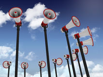 Megaphones on Blue Sky and Clouds Background Royalty Free Stock Photo