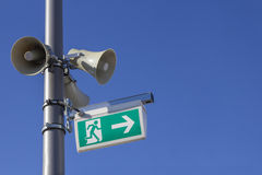 Megaphones and emergency exit sign Royalty Free Stock Photos