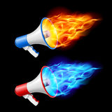 Megaphones in flame Royalty Free Stock Photo