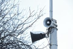 Megaphones on pole outdoors Stock Photography