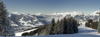 Megeve 2010 (1). Panoramic view from top of Megeve ski resort with pistes in the foreground, Megeve, France royalty free stock images