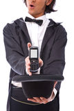 Megician with mobile phone Stock Photo