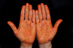 Mehandi. A design on hands against a black background Royalty Free Stock Image