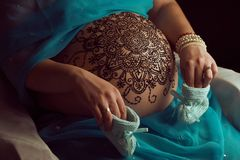 Mandala with henna on an pregnancy woman's belly Royalty Free Stock Image