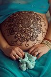 Mandala with henna on an pregnancy woman's belly Royalty Free Stock Photo