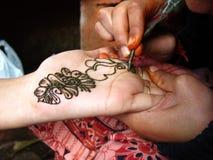 Mehendi Hands. A girl applying mehendi or henna on hands Royalty Free Stock Images