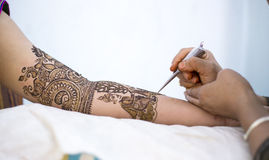 Mehendi or Hena or Hina. An Indian bride getting ready with Mehendi or Henna an Indian style tattoo royalty free stock photo