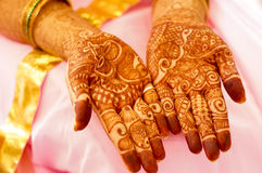 Mehendi (henna) designs on hands of woman. Mehendi (henna) used to decorate the palms of a woman in a pink saree. Mehendi is widely used in India and Pakistan royalty free stock images