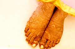 Mehendi (henna) designs on hands of woman. Mehendi (henna) used to decorate the palms of a woman in a pink saree. Mehendi is widely used in India and Pakistan stock images