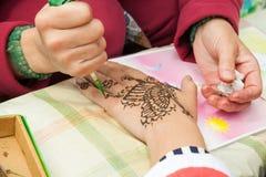 Mehndi application on woman hand, skin decoration Royalty Free Stock Photography