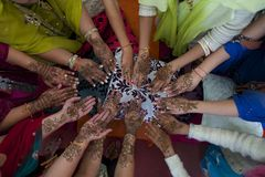 Mehndi Circle. Ladies at a wedding showing off their henna art on hands Royalty Free Stock Images