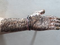 Mehndi, A design hands with henna, tamporary tattoo. A design made on hand with Henna, A temporary henna tattto, reddish browndye stock image