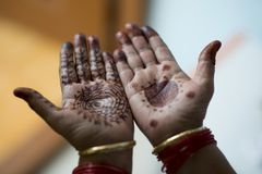 Mehndi design on palms. Dark Mehndi design on human palm royalty free stock images