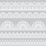 Mehndi, Indian Henna tattoo seamless white pattern on grey background Royalty Free Stock Images