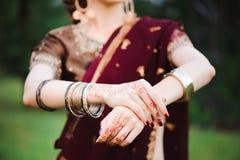 Mehndi tattoo. Woman Hands with black henna tattoos. India national traditions. Mehndi tattoo. Woman Hands with black henna tattoos. India national traditions royalty free stock photo