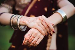 Mehndi tattoo. Woman Hands with black henna tattoos. India national traditions. Mehndi tattoo. Woman Hands with black henna tattoos. India national traditions royalty free stock photography