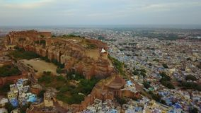 Mehrangarh Fort with Jodhpur city scape. A UNESCO World heritage site at Jodhpur, Rajasthan, India. Aerial shot.Mehrangarh Fort with Jodhpur city scape. A stock footage