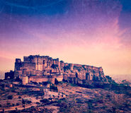 Mehrangarh Fort, Jodhpur, Rajasthan, India. Vintage retro hipster style travel image of Mehrangarh Fort in twilight on sunset, Jodhpur, Rajasthan, India with Royalty Free Stock Image