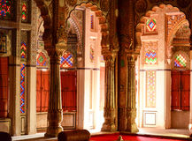 Mehrangarh Pearl Palace interior, Rajasthan, India. Stained glass windows and carved columns Stock Photos