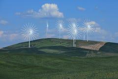 Mehrfache Windkraftanlagen in Palouse Washington Time glitten zum Spaß hinab Stockfoto
