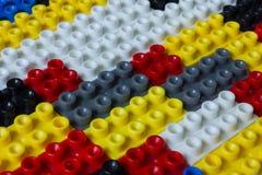Mehrfarbenplastik blockiert Hintergrund Stockbilder