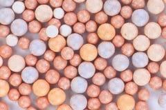 Mehrfarbenrougehintergrund der beige Kosmetik Stockbilder
