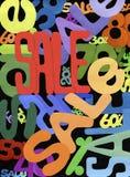 Mehrfarbenzusammensetzung einiger Güsse des Wortverkaufs auf einem schwarzen Hintergrund Lizenzfreies Stockfoto