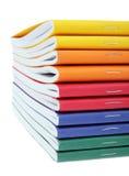 Mehrfarbige Übungsbücher stockbild