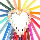 Mehrfarbige Bleistifte, die Herz bilden Lizenzfreies Stockfoto