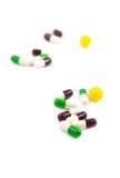 Mehrfarbige defocused Medizinpillen Stockfotos