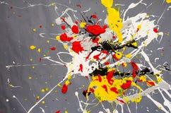 Mehrfarbige Farbfleck- Verunstaltung auf dem grauen Hintergrund lizenzfreie stockfotografie