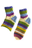 Mehrfarbige gestrickte Socken getrennt auf Weiß Stockbild
