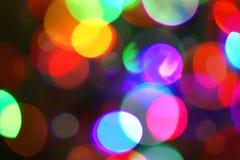 Mehrfarbige helle Stellen Defocused Zusammenfassung beleuchtet Feiertagshintergrund Lizenzfreies Stockbild