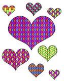 Mehrfarbige Herzen auf einem weißen Hintergrund Lizenzfreie Stockbilder