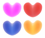 Mehrfarbige Herzen auf einem weißen Hintergrund Lizenzfreies Stockfoto