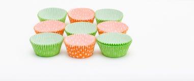 Mehrfarbige Papierformen für Muffins Stockfotografie