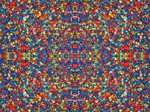 Mehrfarbige Steine. Kaleidoskophintergrund. Stockfotografie