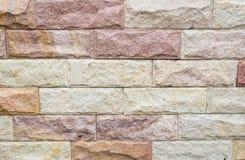 Mehrfarbige Steinwand Stockbilder