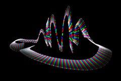 Mehrfarbige wellenförmige Spur der lichtemittierenden Diode Stockfotografie