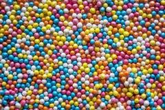 Mehrfarbiger Pastell besprüht Hintergrund Bunte kleine Süßigkeiten Ostern, Hintergrund, Beschaffenheit für Ostern, Kopienraum Sch Stockfotografie