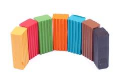 Mehrfarbiger Plasticine auf einem Halbrund lokalisierten Hintergrund Lizenzfreies Stockfoto