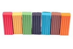 Mehrfarbiger Plasticine auf einem lokalisierten Hintergrund Lizenzfreie Stockfotos