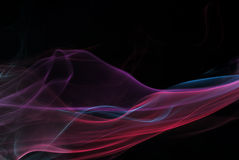 Mehrfarbiger Rauch auf schwarzem Hintergrund Stockfotografie