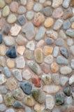 Mehrfarbiger Steinwandhintergrund Stockfoto